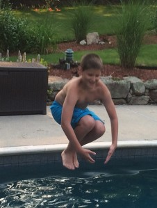Jumping into the pool.