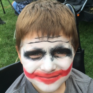 RIbfest 2015. Never get your face painted like the Joker.